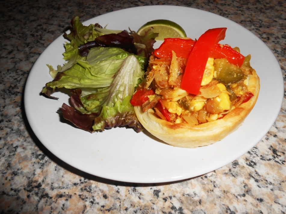 Yummy ackee on saltfish tart with side salad and lime.